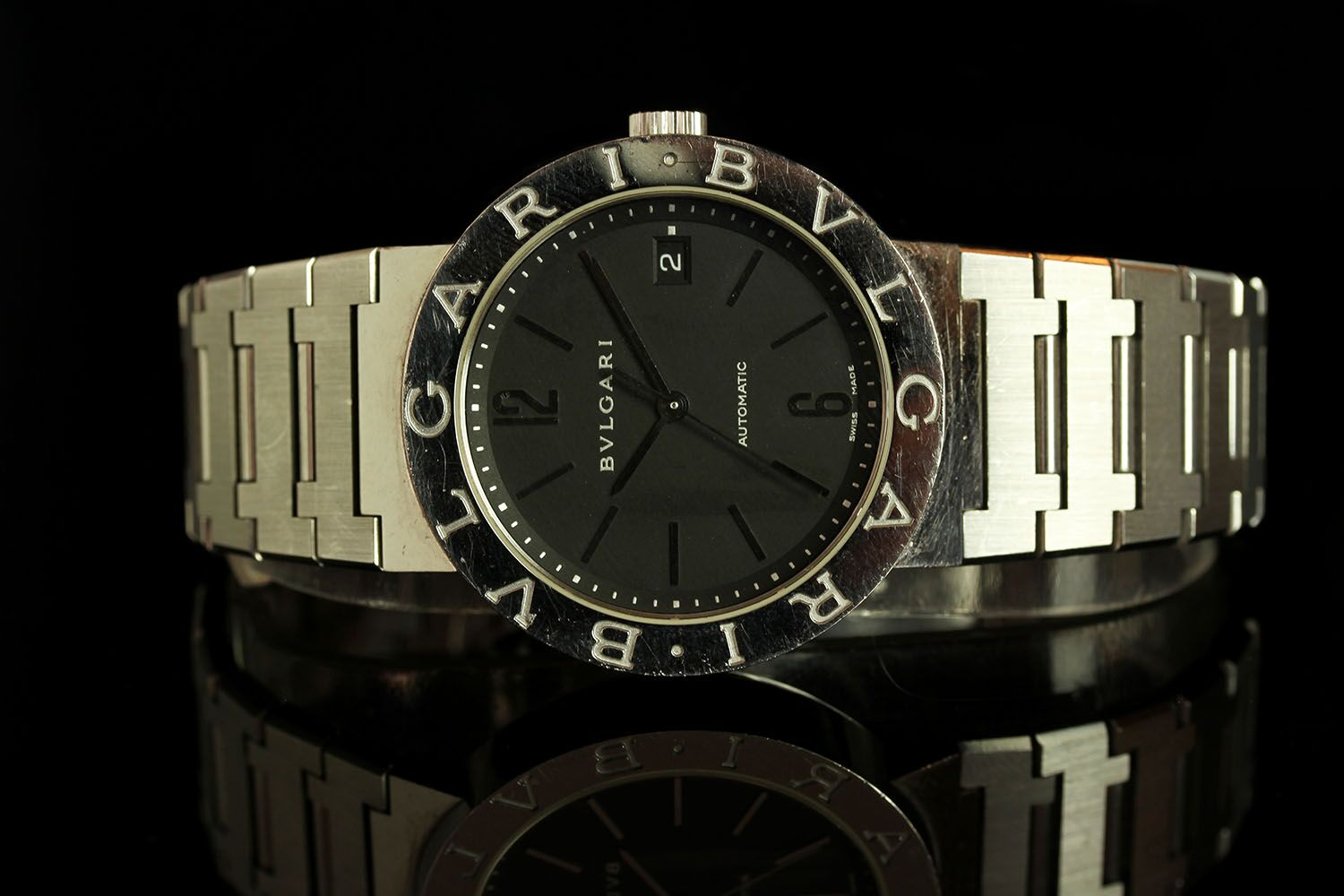 GENTLEMANS BVLGARI BB38SS,round, black dial with silver hands, arabic and baton markers.named