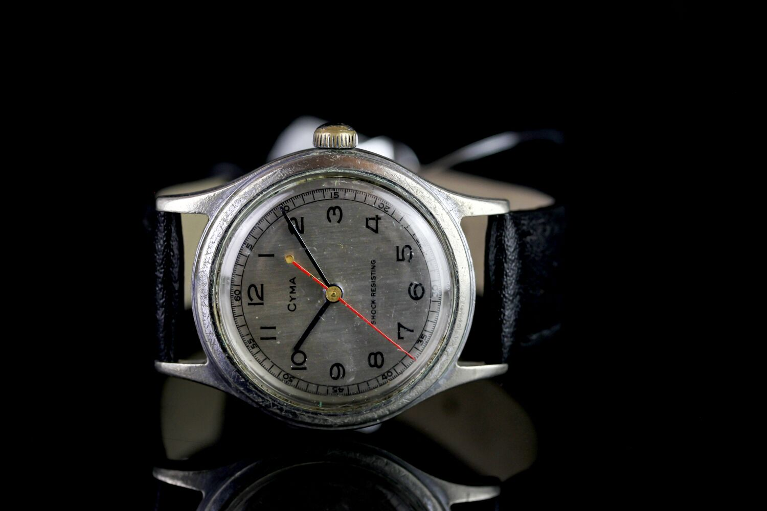 MID SIZE CYMA SHOCK RESISTING VINTAGE WRISTWATCH, circular brushed silver dial with black arabic
