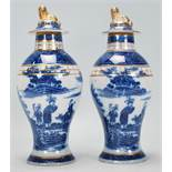 Two early 19th Century blue and white pearlware lidded baluster vases having transfer printed