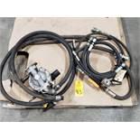 Diaphragm pump with hoses.