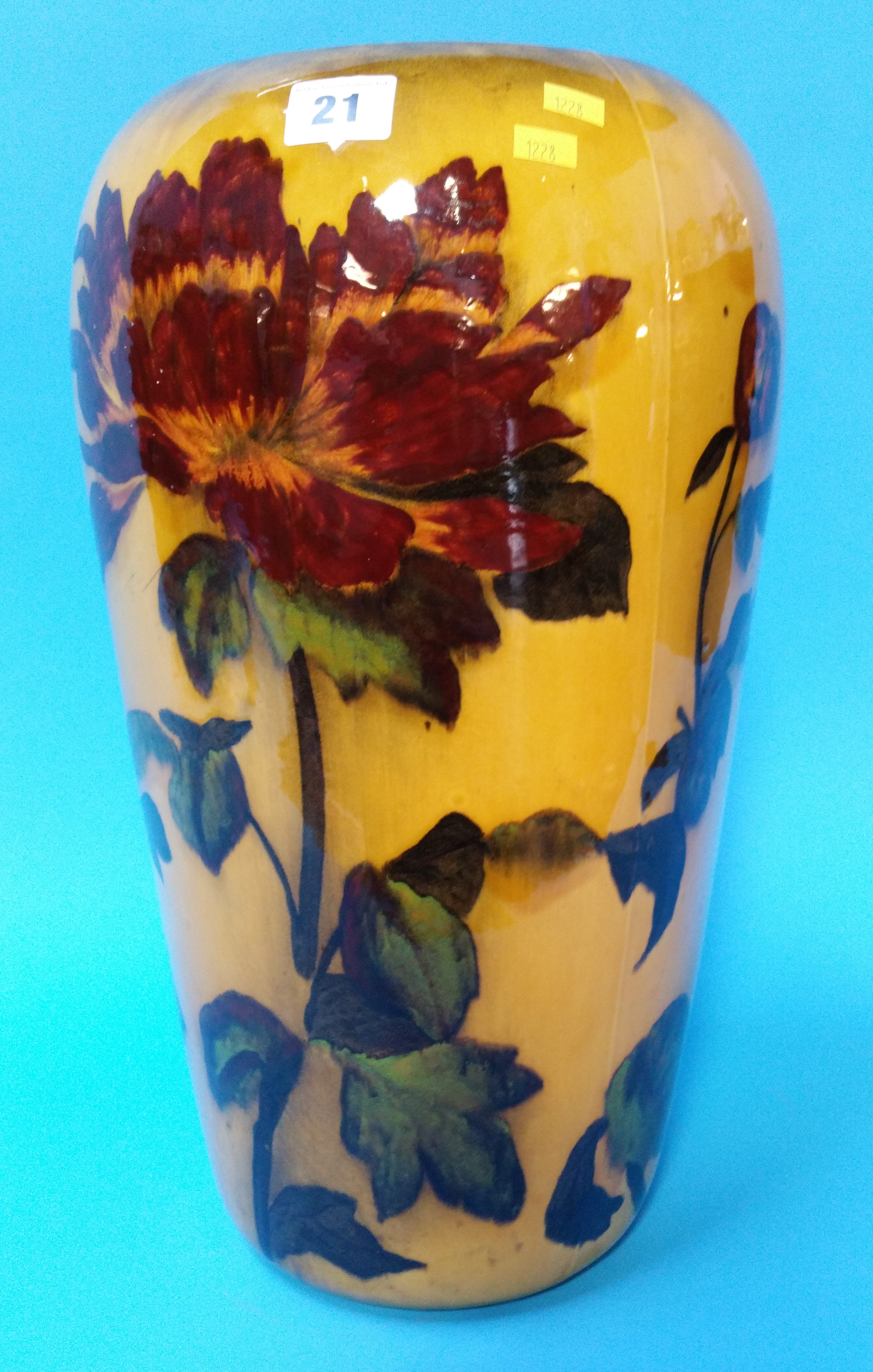 Lot 21 - A tall Madras ware vase decorated with autumnal le