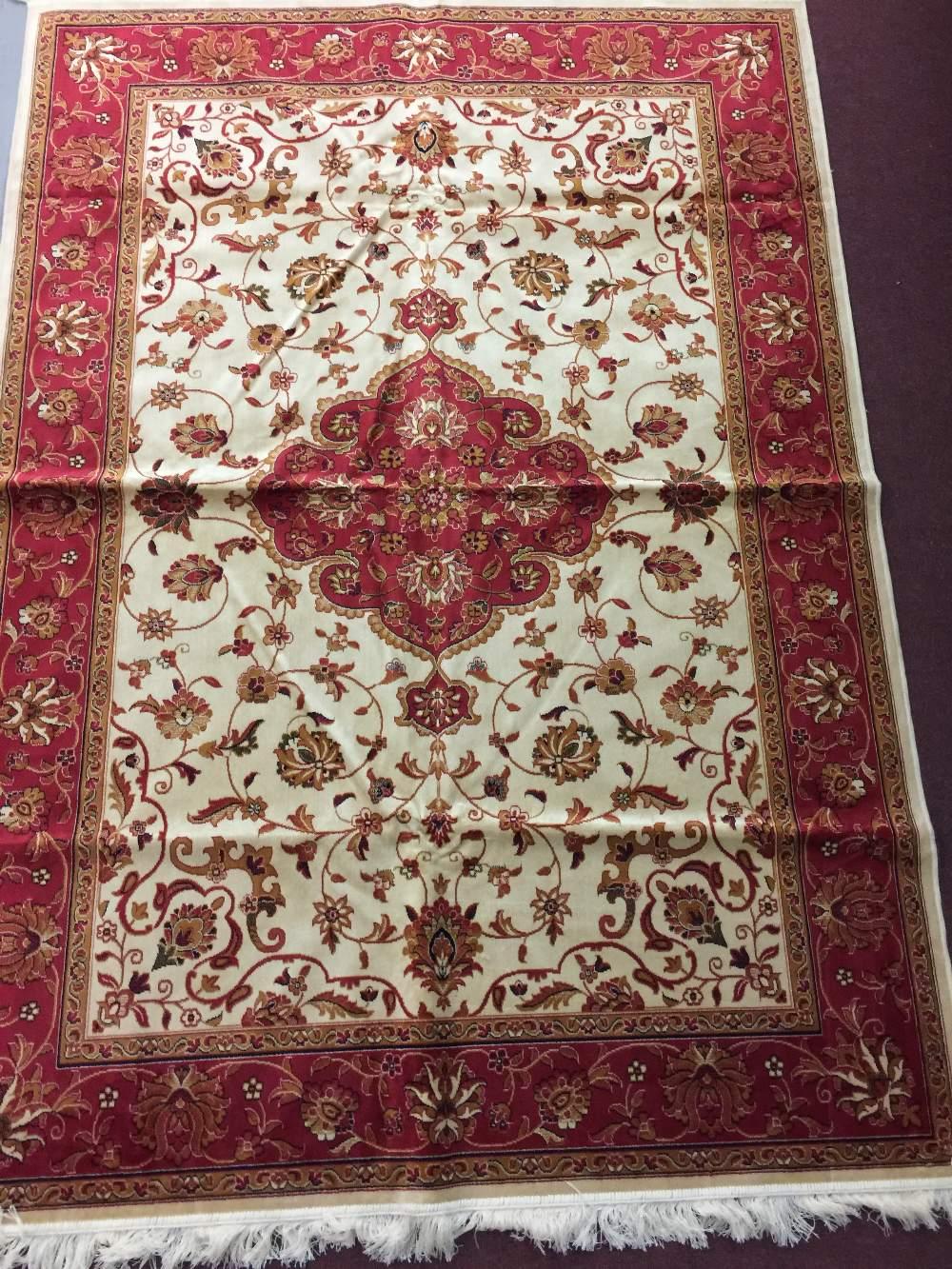 Lot 34 - @21st cent. Carpets: Keshan carpet, beige ground. 2.30 x 1.60.