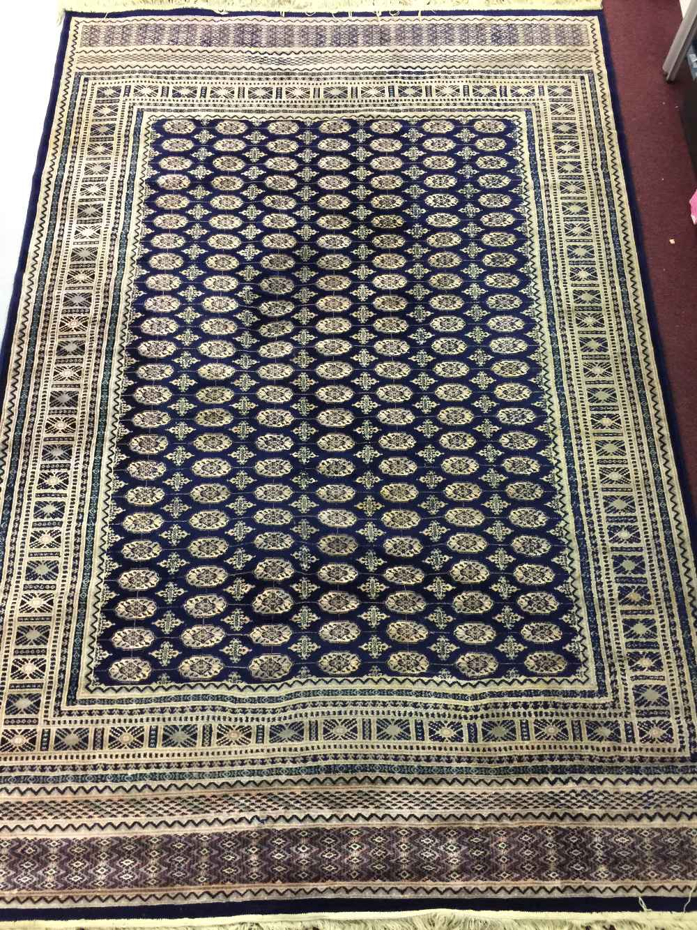 Lot 38 - 20th cent. Machine made Turkish rug (with lead seal). Dark blue ground, nine borders, central