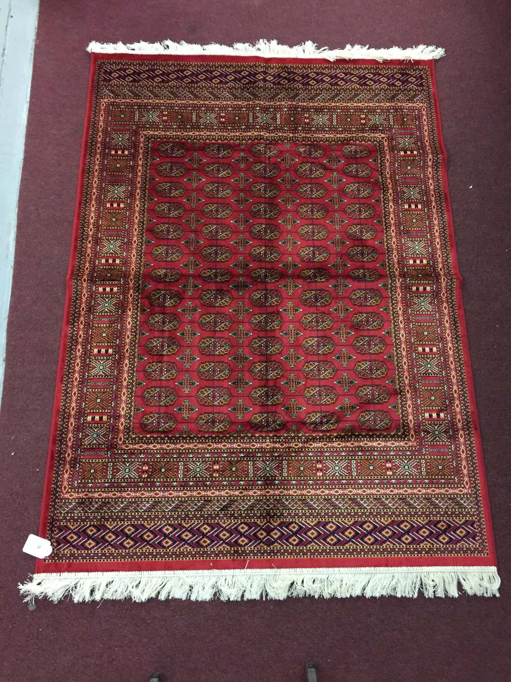 Lot 37 - @21st cent. Rugs: Bokhara rug, red ground. 1.90 x 1.40
