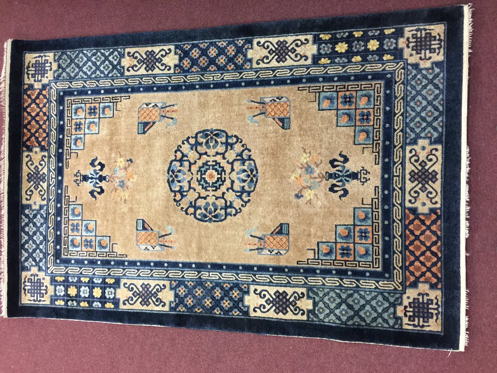 Lot 42 - Rugs: Modern weave washed Eastern style carpet, beige ground, blue surround, stylised geometric