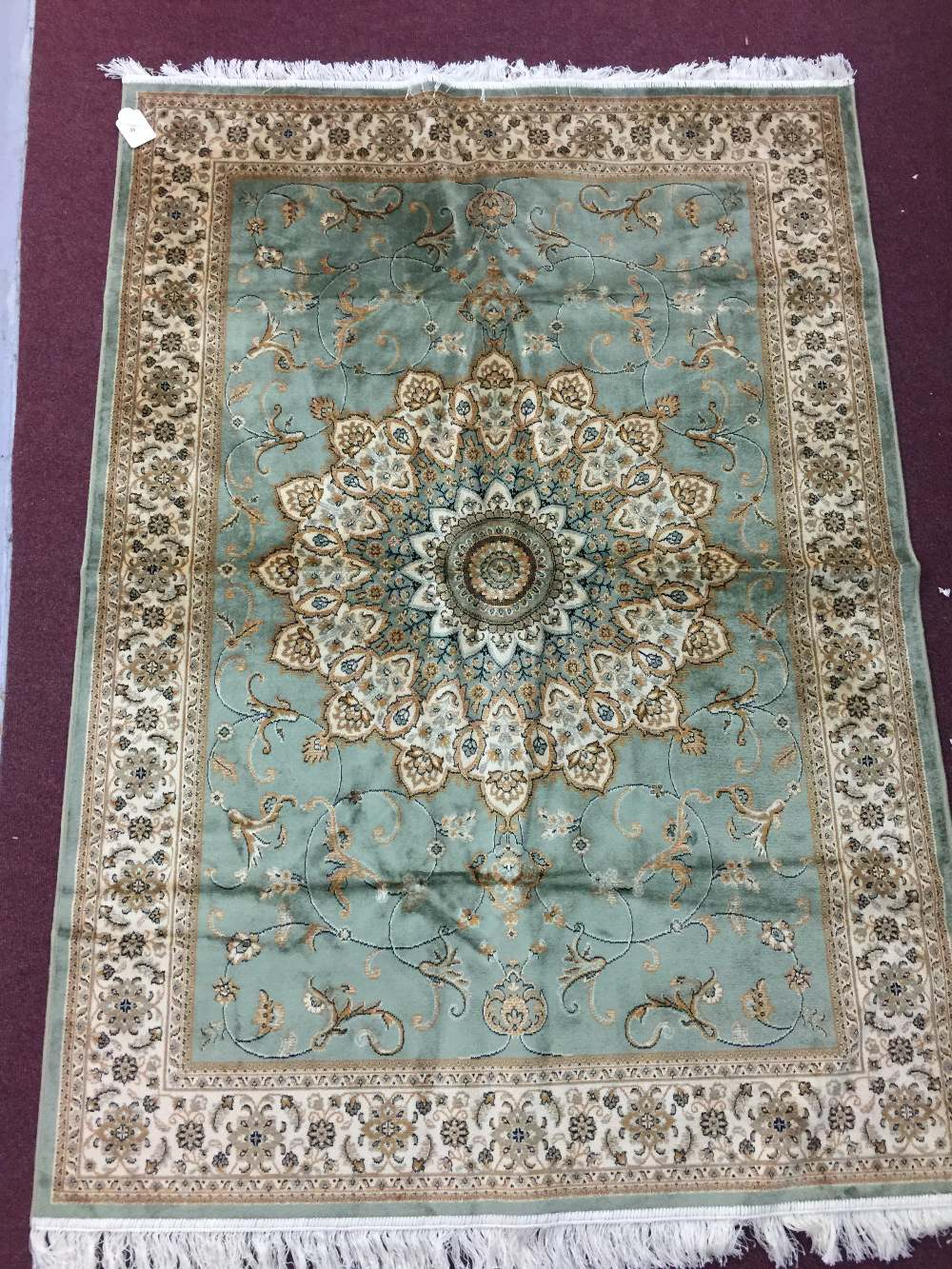 Lot 35 - @21st cent Rugs: Keshan rug, green ground. 1.90 x 1.40.