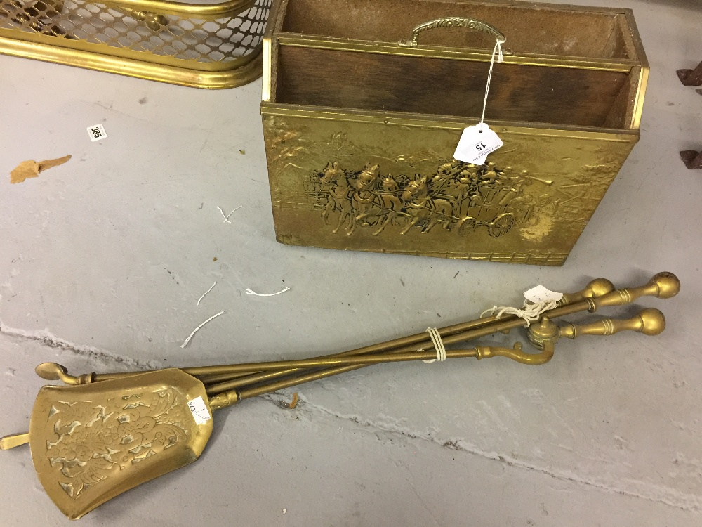 Lot 15 - Brassware: 20th cent. Set of fire tools, poker, shovel tongs and a brass magazine rack.