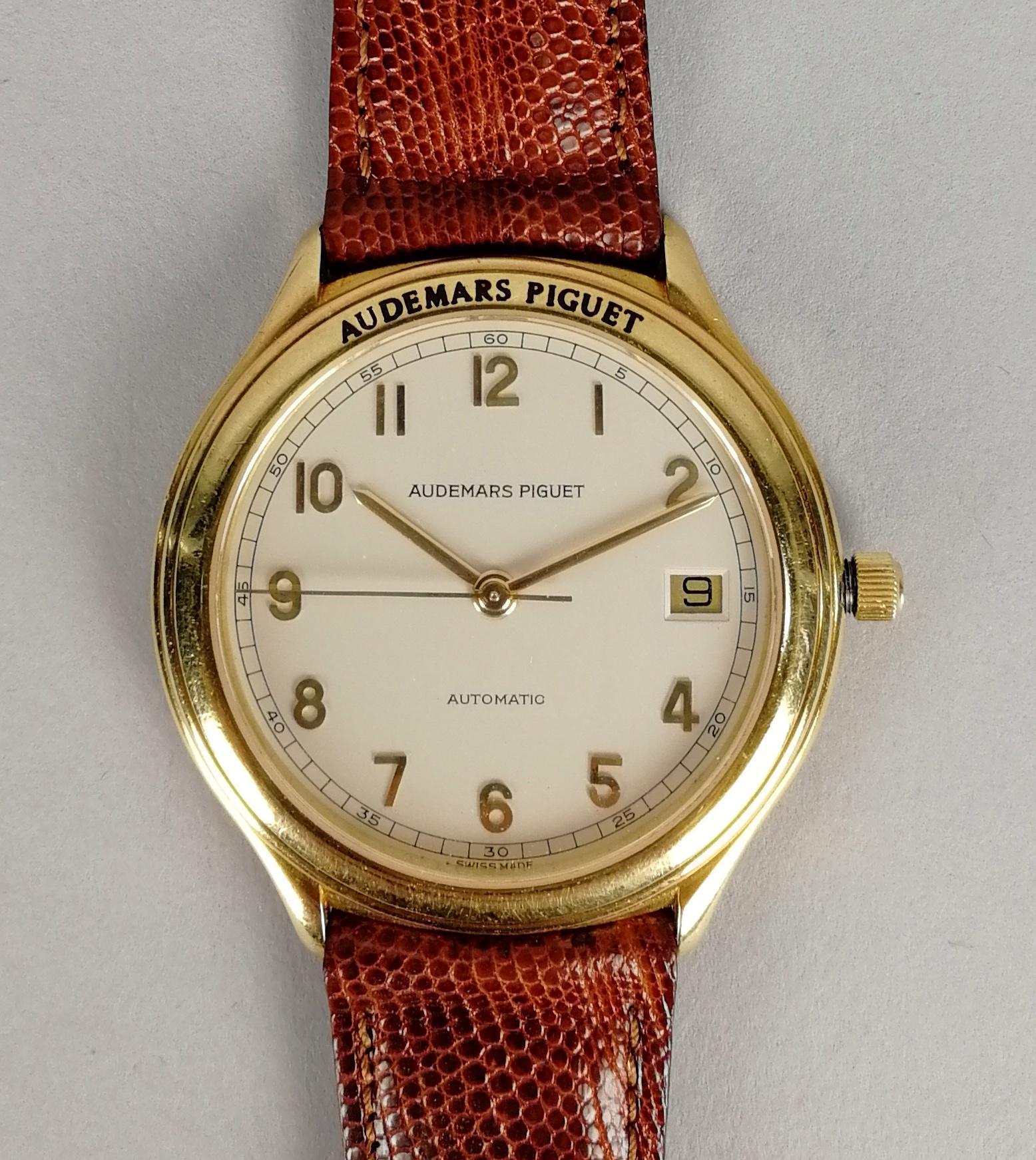 Lot 12 - AUDEMARS PIGUET. Orologio da uomo automatico in oro 18 kt. con datario, modello Solo Tempo. Numero