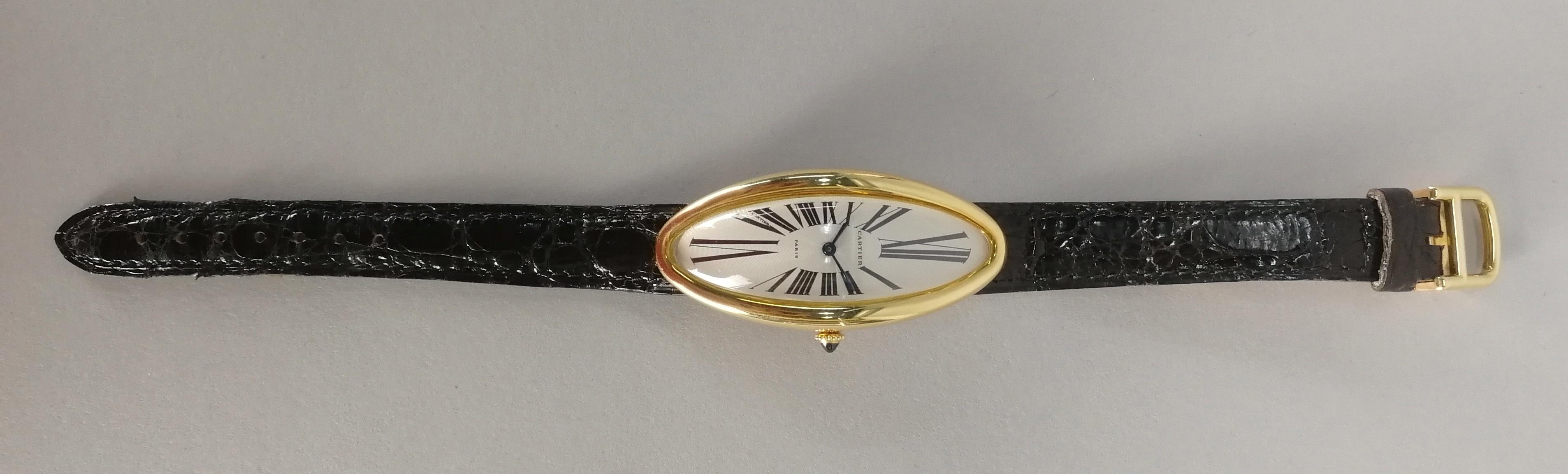 Lot 42 - CARTIER. Orologio in oro giallo 18 kt. a carica automatica, modello ovale, con cinturino Cartier a