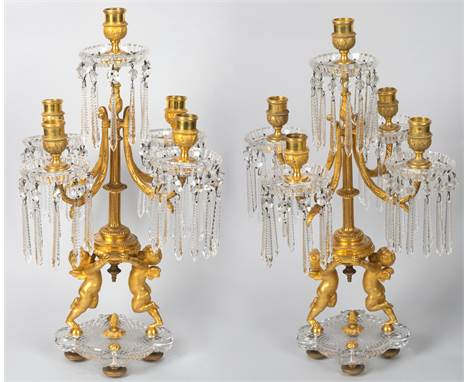 A PAIR OF ORMOLU AND CUT CRYSTAL TABLE CANDELABRA, BACCARATwith five candle holders each with ten icicle cut crystals mounted