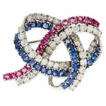 A VINTAGE RUBY, SAPPHIRE AND DIAMOND BROOCH designed as a woven ribbon motif, jewelled with rows
