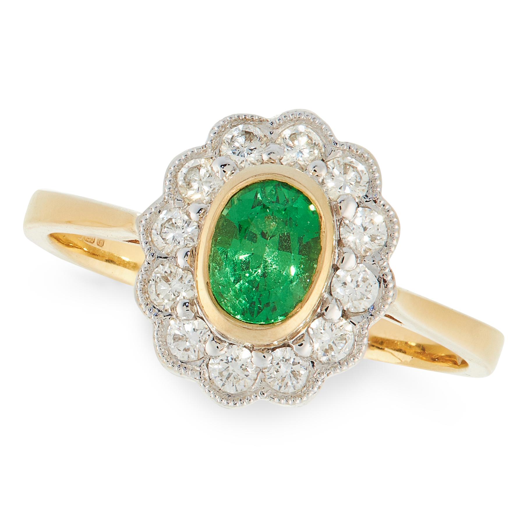 A GREEN GARNET AND DIAMOND DRESS RING in 18ct yellow gold, set with an oval cut green garnet