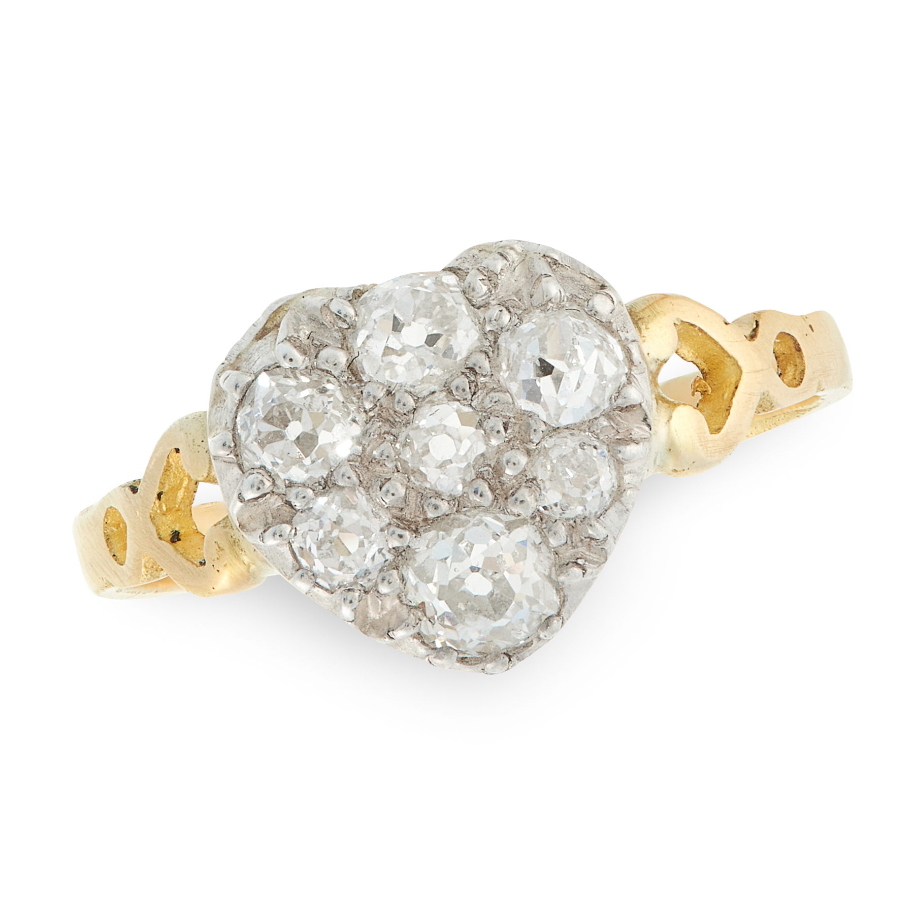 AN ANTIQUE DIAMOND DRESS RING in high carat yellow gold and silver, the face in the form of a heart,