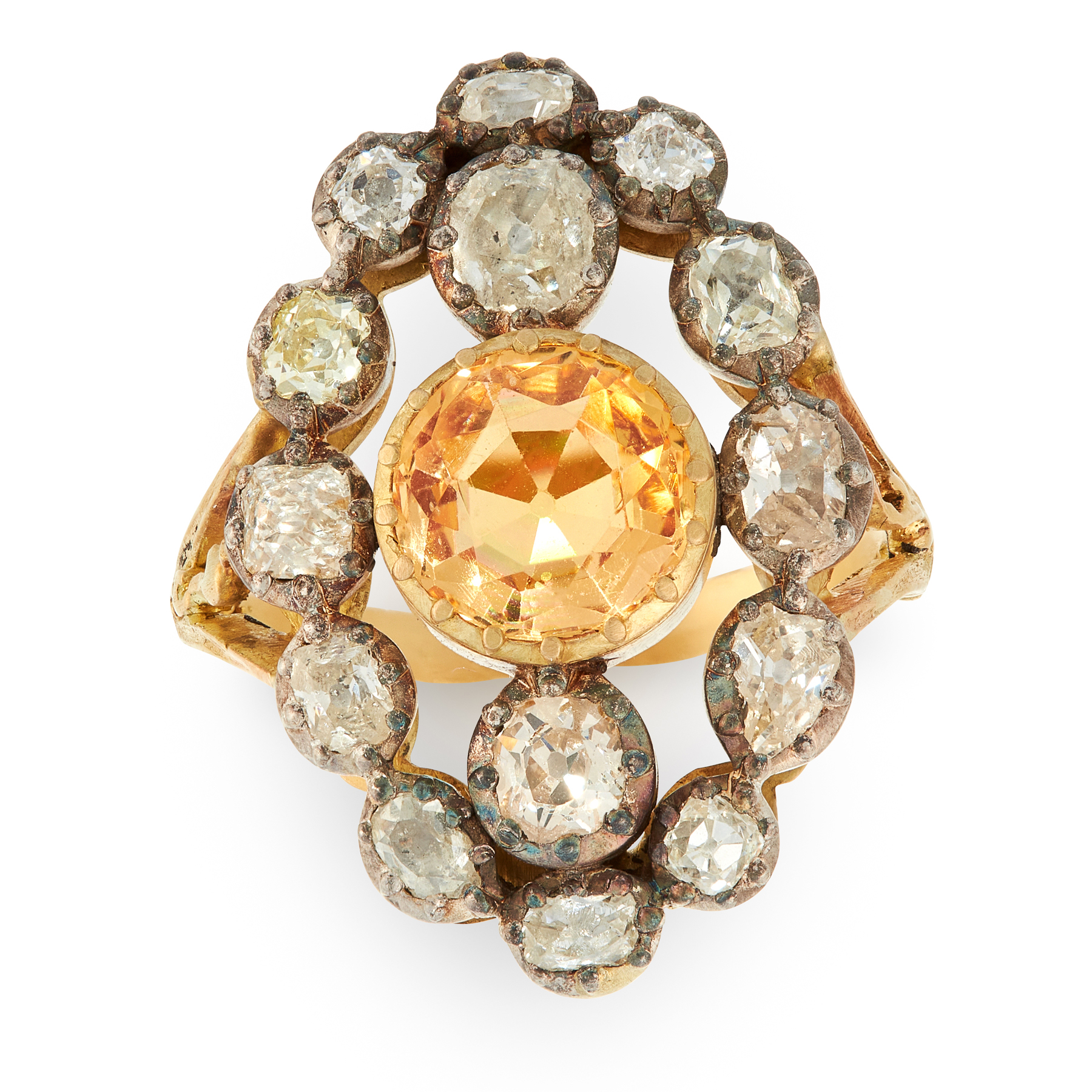 AN ANTIQUE IMPERIAL TOPAZ AND DIAMOND RING in high carat yellow gold and silver, set with a round