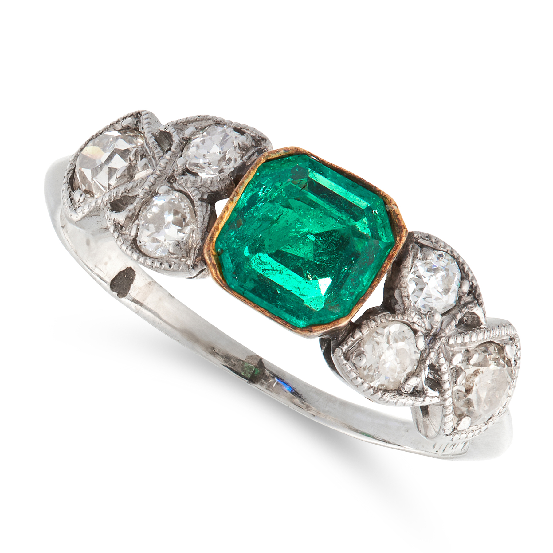 AN EMERALD AND DIAMOND DRESS RING in platinum, set with an emerald cut emerald of 0.37 carats