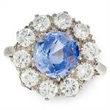 A CEYLON NO HEAT SAPPHIRE AND DIAMOND RING in 18ct white gold and platinum, set with a round cut