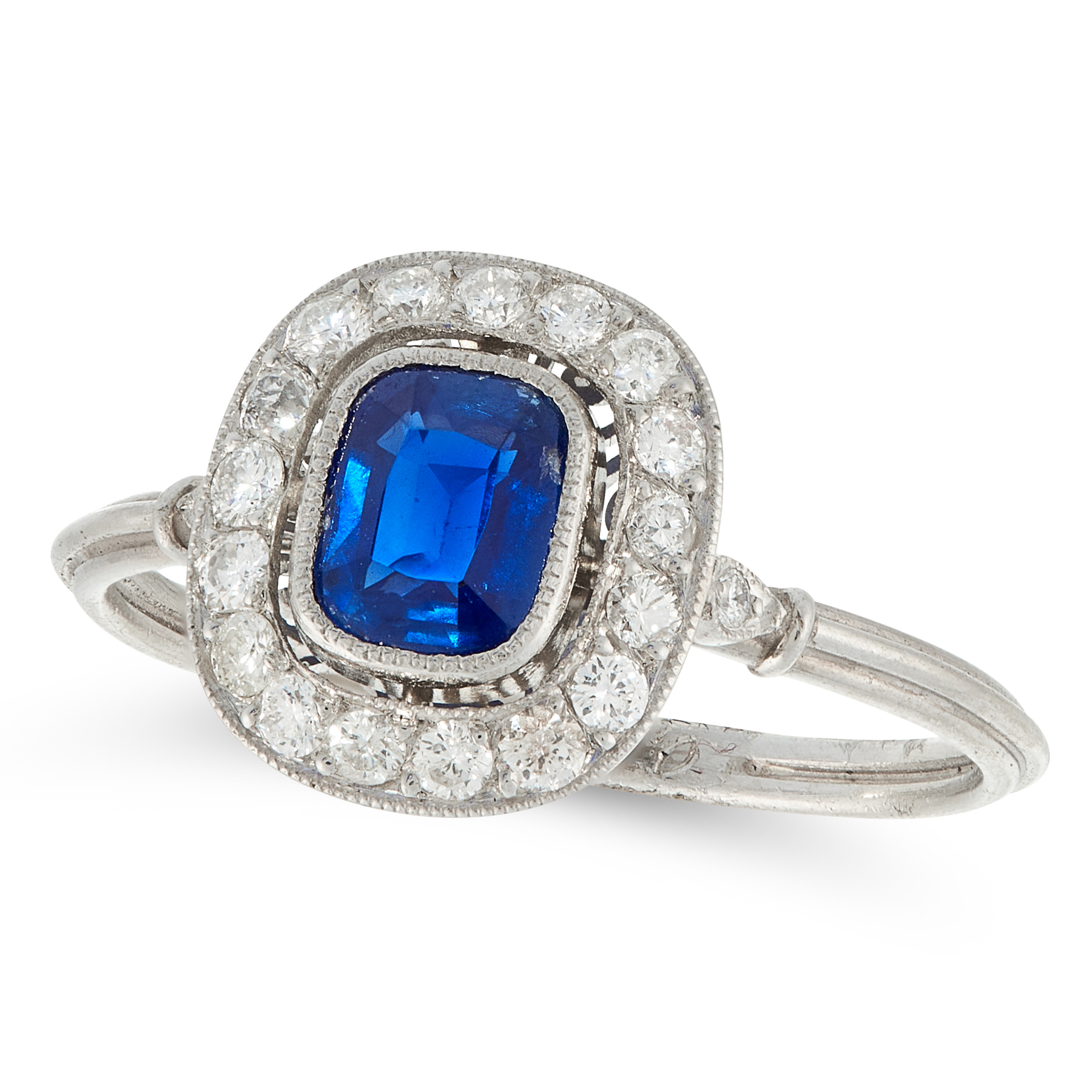 A SAPPHIRE AND DIAMOND DRESS RING in platinum, set with a cushion cut sapphire of 0.77 carats within