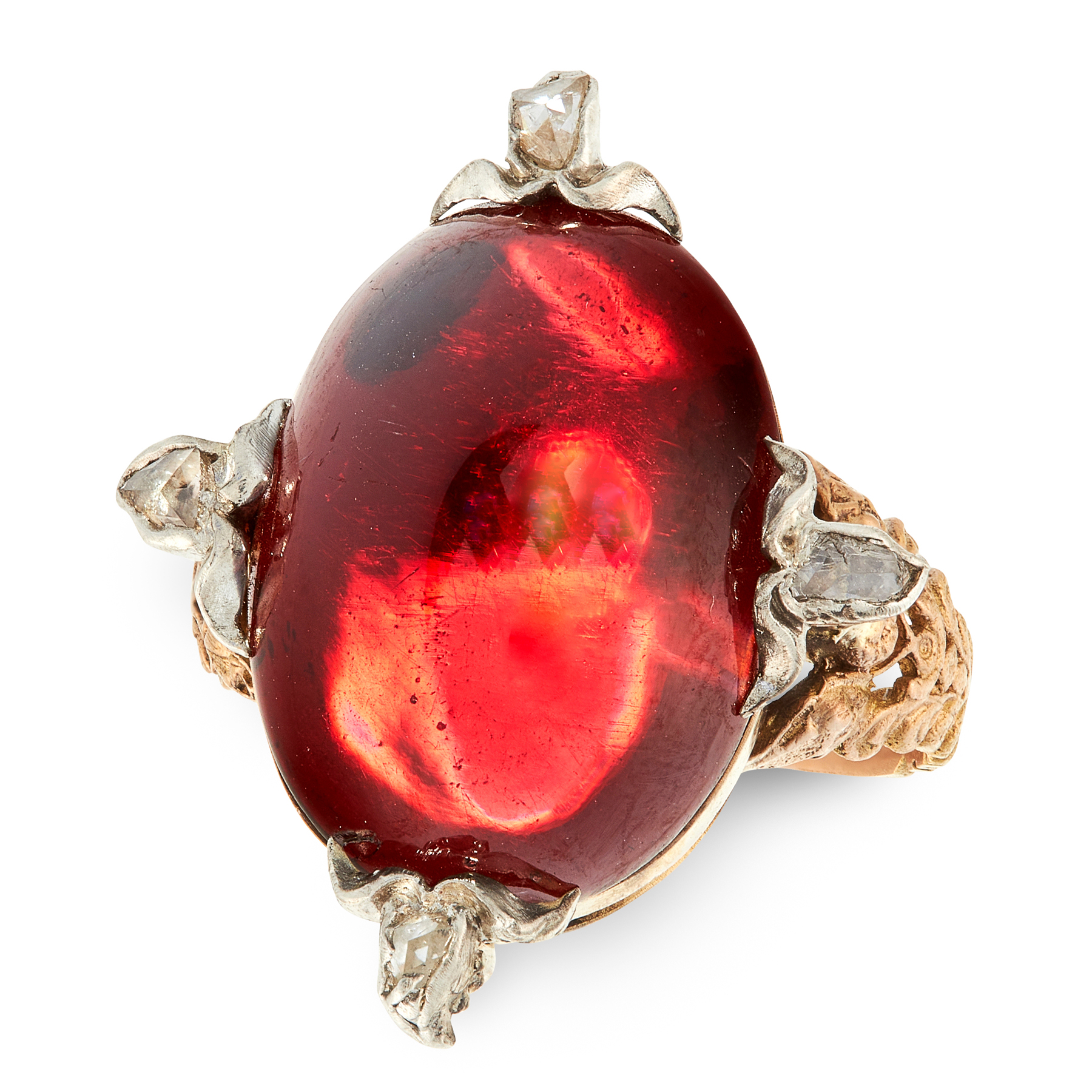 AN ANTIQUE GARNET AND DIAMOND RING in yellow gold and silver, set with an oval cabochon garnet