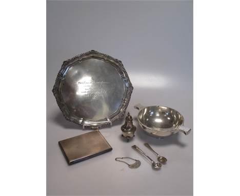 A silver waiter, a silver quaich, a silver pocket cigarette case, two silver condiment spoons, a silver miniature pepperette