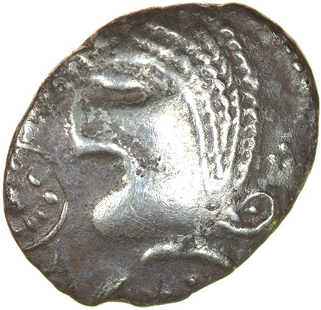 Lot 11 - Mossop Proto Head. Talbot Large Flan A, dies F/12.c.50-40 BC. Celtic silver unit. 13-16mm. 1.27g.