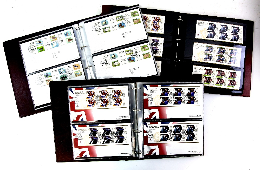 Lot 2054 - Great Britain, 3 Albums 2012 Olympics and Para Olympics stamps & First Day Covers, Post and Go