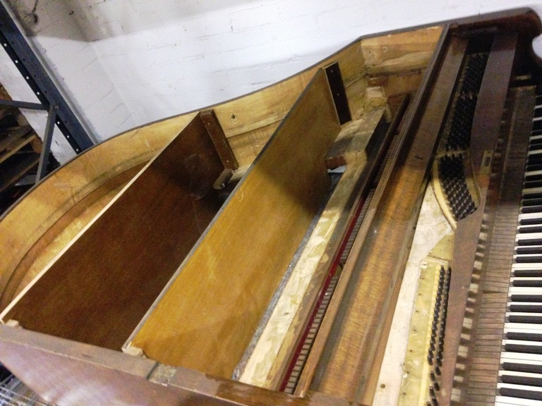 Lot 16 - Distressed Grand Piano Bookshelves