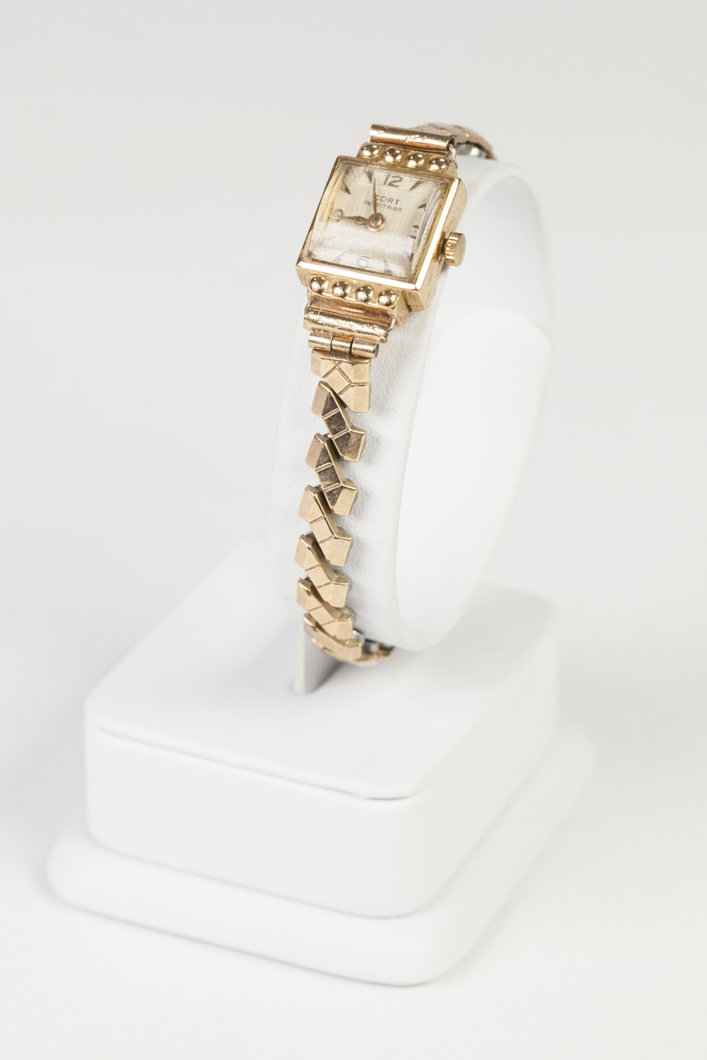 Lot 9 - LADY'S CORT 18ct GOLD CASED SMALL WRIST WATCH, with 17 jewelled movement, square silvered dial, gold