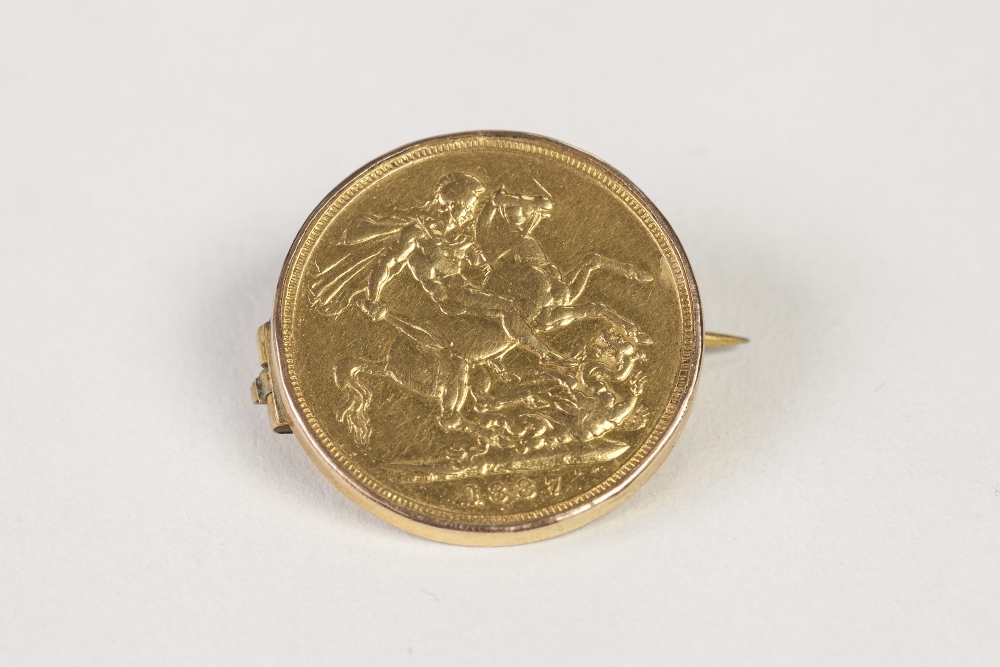 Lot 56 - VICTORIAN GOLD SOVEREIGN 1887, with loose gold frame as a brooch, 9.5gms gross