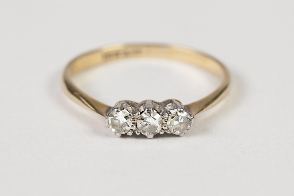 Lot 39 - AN 18ct GOLD AND PLATINUM RING, claw set with a row of three diamonds, approx 1/3ct in total, 1.7gms