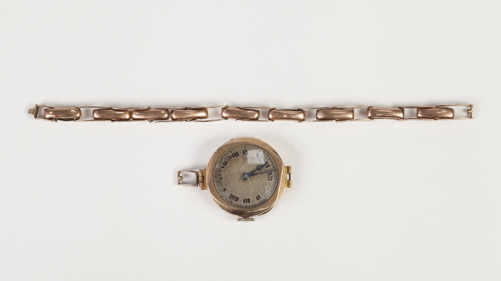 Lot 4 - BUREN LADIES 9CT GOLD CASED WRIST WATCH with silvered Roman dial and 9ct gold expanding bracelet (