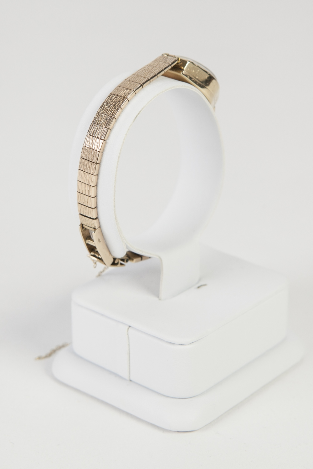 Lot 11 - LADY'S ROTARY 9ct GOLD WRISTWATCH with 15 jewel movement, small silvered circular Arabic dial and