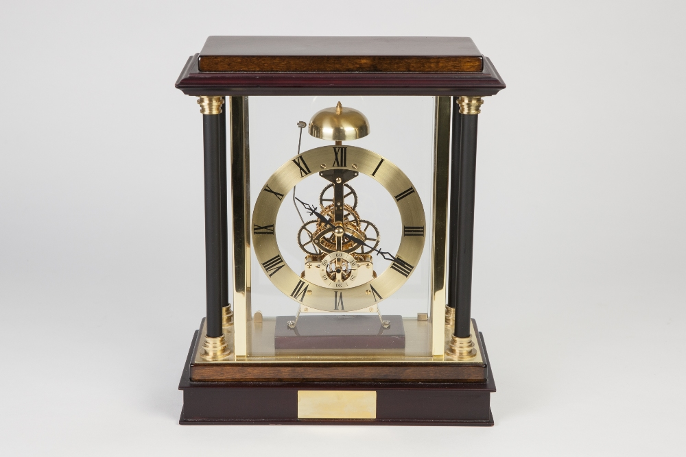 Lot 27 - MODERN SKELETON CLOCK, with battery operated movement striking on a bell surmounting and having a