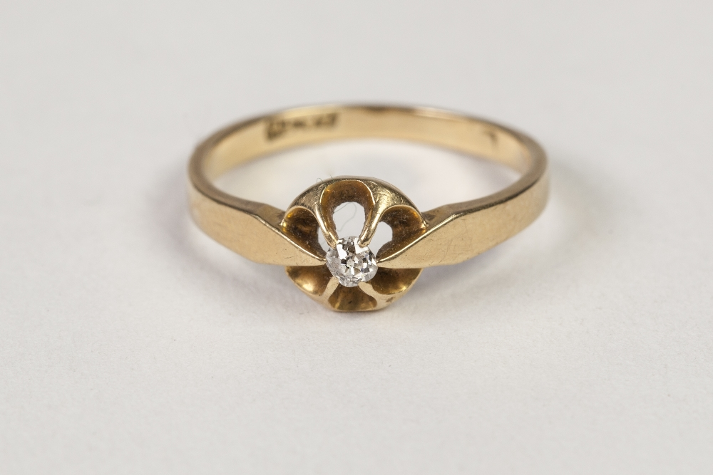 Lot 50 - GOLD RING, set with a small solitaire diamond, approx .07ct, 2.3gms