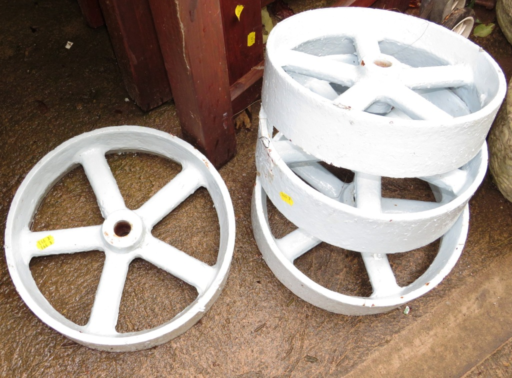 Lot 10 - FOUR PAINTED VINTAGE CAST METAL WHEELS