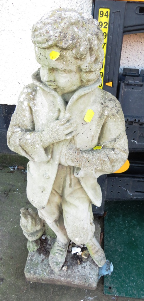 Lot 24 - STONE GARDEN STATUE OF BOY IN COAT