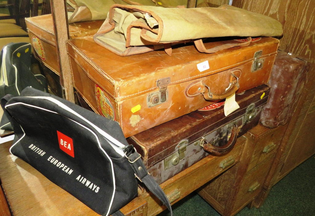 Lot 93 - THREE VINTAGE LEATHER SUITCASES (SOME WITH PAPER LABELS), BRITISH AIRWAYS CARRY-ON BAG AND ONE OTHER