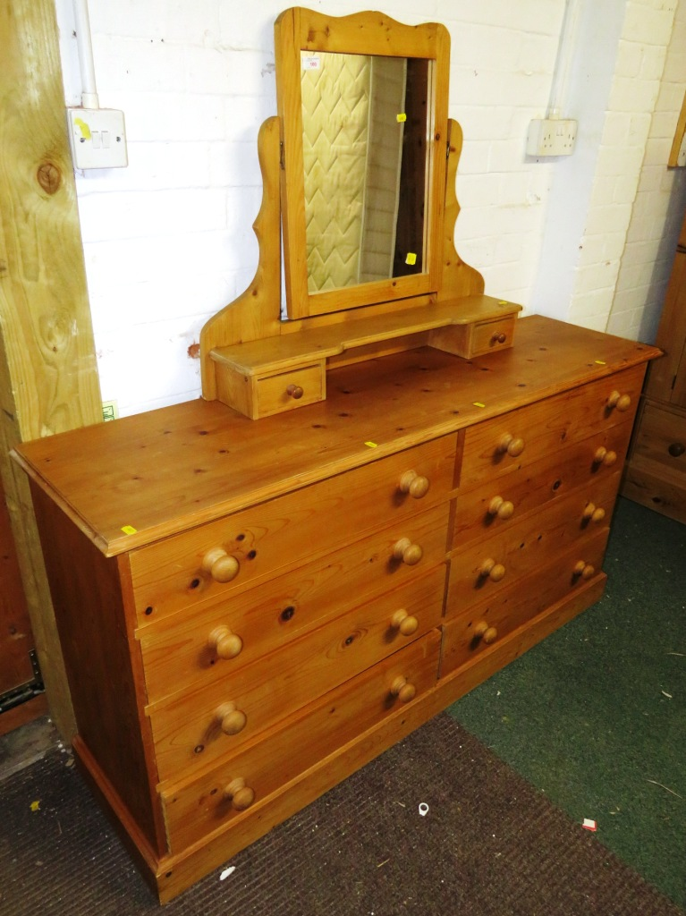 Lot 100 - PINE CHEST OF EIGHT DRAWERS AND DRESSING TABLE SWING MIRROR WITH TWO DRAWERS