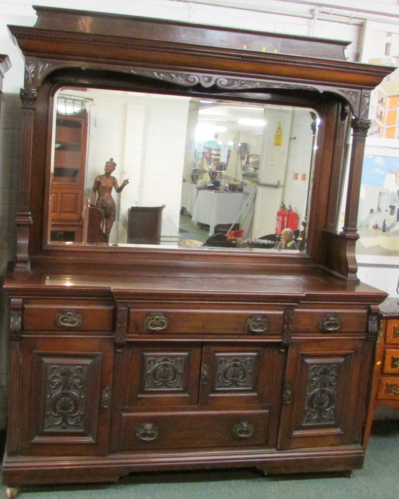 Lot 90 - A late 19th / early 20th century large breakfront sideboard, the back panel with a single plain