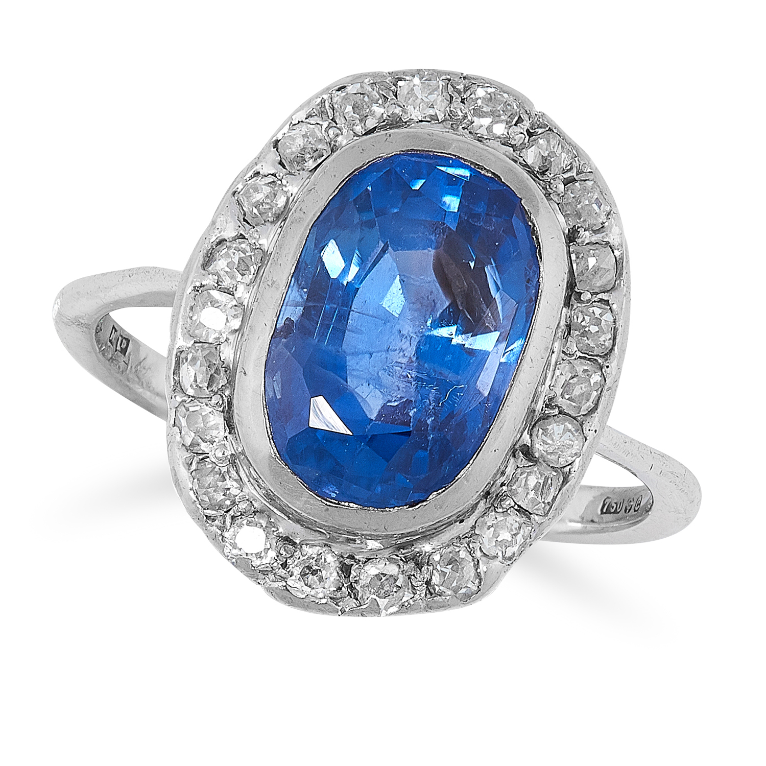 A COLOUR CHANGE SAPPHIRE AND DIAMOND CLUSTER RING in 18ct white gold, set with a central cushion cut
