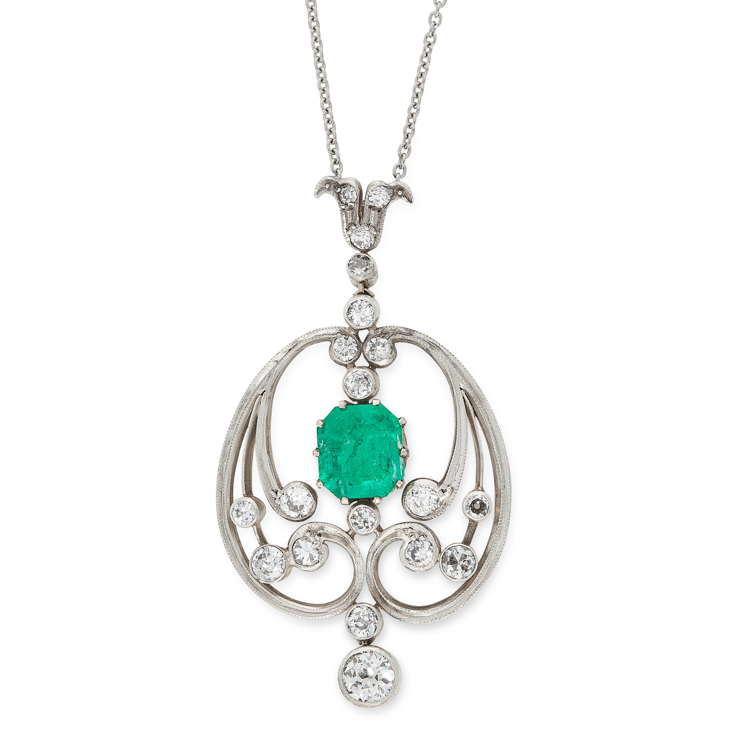 AN ART NOUVEAU EMERALD AND DIAMOND PENDANT in yellow gold and silver, set with a central emerald cut