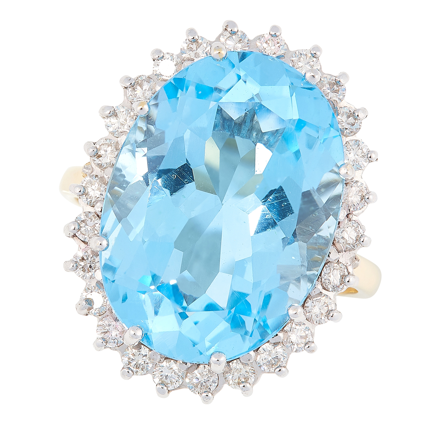 A TOPAZ AND DIAMOND CLUSTER RING in 18ct yellow gold, set with an oval cut topaz in a border of