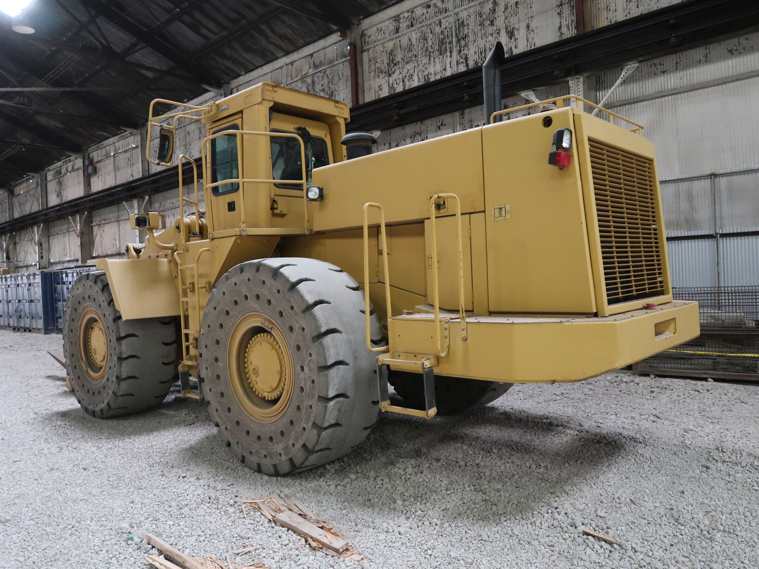 "Lot 1039 - CATERPILLAR MODEL 988 ARTICULATING WHEEL LOADER; S/N 8Y601373, SOLID TIRE, 84"" FORKS, 754 HOURS"