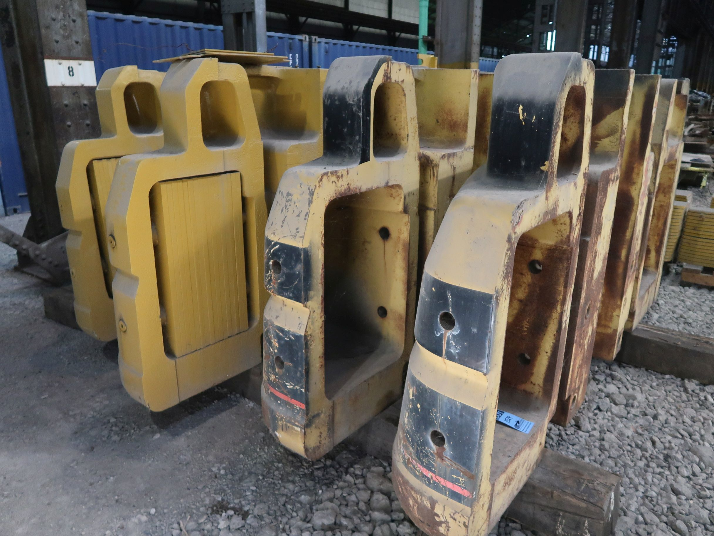 Lot 1524 - CATERPILLAR MODEL 345 COUNTER WEIGHTS, SOME MODIFIED