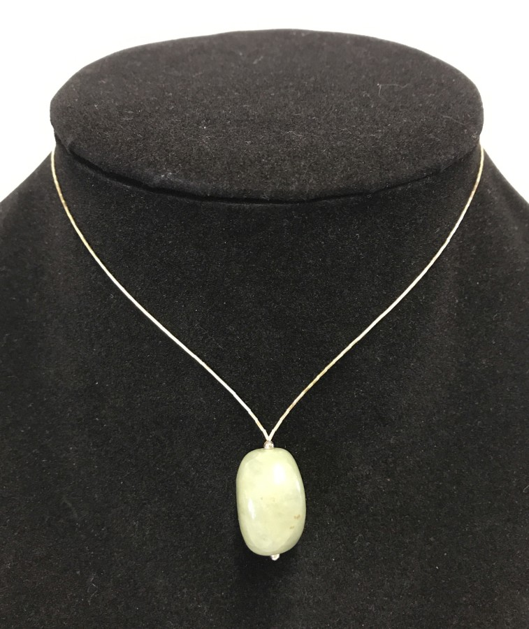 Lot 1043 - An apple jade drop pendant necklace with 925 silver clasp.