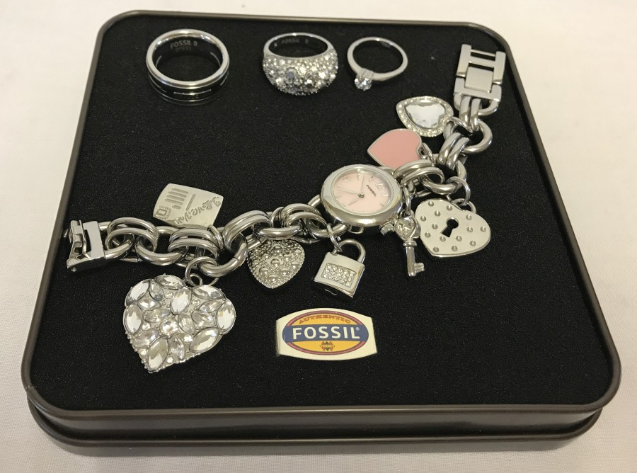 Lot 1042 - 3 rings by Fossil together with a Fossil charm watch.