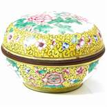 A CHINESE CLOISONNE ENAMEL BRONZE BOX of circular form, decorated in enamel with pink peonies