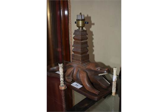 An African Carved Hardwood Crocodile Table Lamp A Carved Bone Cheroot Holder A Carved Bone Mini
