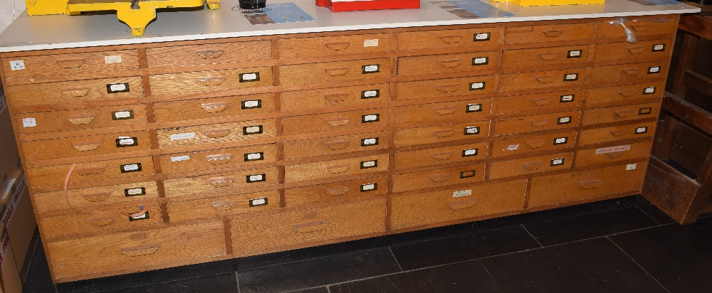 Lot 60 - *Chest of drawers. A large 20th century 'shop counter style' chest of drawers (with contents),