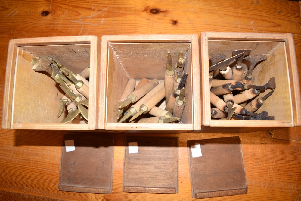 Lot 30 - *Decorative finishing tools. A collection of twelve brass decorative finishing tools, of modern &