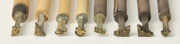 Lot 29 - *Decorative finishing tools. A collection of twenty-two brass decorative finishing tools, of
